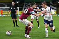 Tottenham Hotspur midfielder Giovani Lo Celso (18) trying to find a way past Burnley defender Kevin Long (28) during the Premier League match between Burnley and Tottenham Hotspur at Turf Moor, Burnley, England on 26 October 2020.