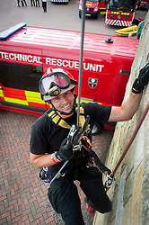 Fire Fighter Darren Monette of the South Yorkshire Fire Service Technical Rescue Unit demonstrates Abseiling Techniques at Aston Park fire station open day on Saturday.113933-05.13 August 2011  Image © Paul David Drabble