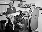 Y-490128-01.  Portland Police detectives inventory confiscated dice.  Mike Elliot gambling raid. Ramapo Hotel basement, 1337 SW Washington January 28, 1949.