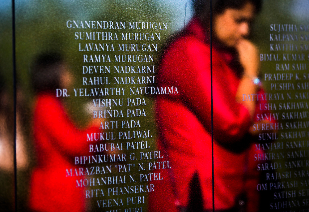 A woman is reflected behind the names of the victims at at the Air India Memorial during 30th anniversary service for families of victims of the Air India bombing in Toronto, Tuesday June 23, 2015.   (Mark Blinch for the Globe and Mail)