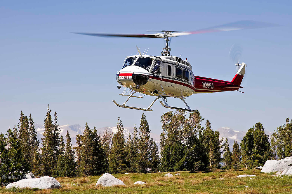 A National Parks rescue helicopter lands in a clearing in the High Sierras in preparation to extract an injured rock climber