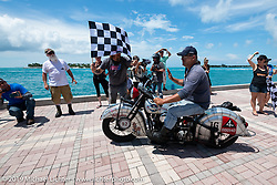 Mark Hill riding his 1940 Indian 4-cylinder over the finish line of the Cross Country Chase motorcycle endurance run from Sault Sainte Marie, MI to Key West, FL. (for vintage bikes from 1930-1948). The Grand Finish in Key West's Mallory Square after the 110 mile Stage-10 ride from Miami to Key West, FL and after covering 2,368 miles of the Cross Country Chase. Sunday, September 15, 2019. Photography ©2019 Michael Lichter.