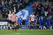 Sunderland players inc George Honeyman (26) stand dejected as Cardiff city players celebrate after they score 3rd goal, scored by Callum Paterson of Cardiff. EFL Skybet championship match, Cardiff city v Sunderland at the Cardiff city stadium in Cardiff, South Wales on Saturday 13th January 2018.<br /> pic by Andrew Orchard, Andrew Orchard sports photography.