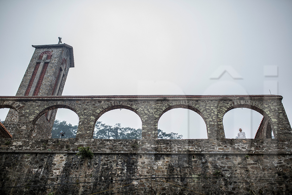 A singer records a video clip in the stone church atop Tam Dao Hill, Vinh Phuc Province, Vietnam, Southeast Asia