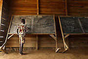 """A boy conjugates the verb """"to play"""" on the blackboard during class at the Podio primary school in the village of Podio, Bas-Sassandra region, Cote d'Ivoire on Friday March 2, 2012."""