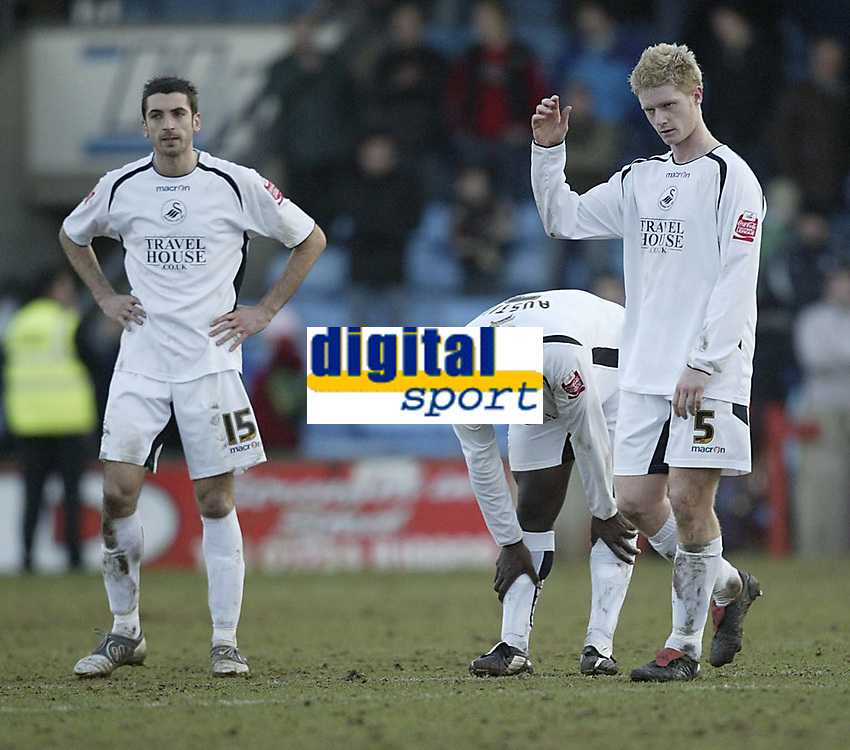 Photo: Aidan Ellis.<br /> Scunthorpe United v Swansea City. Coca Cola League 1. 18/02/2006.<br /> Swansea's Tom Williams, Kevin Austin and Alan Tait cant believe they have let victory slip away in the last minute