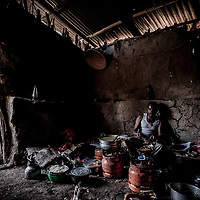 Expedition chef, Tadle Zelalem, in his makeshift kitchen appropriated from a local villager, during our 9-day traverse of Ethiopia's Simien Mountains.