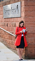 (c) Licensed to London News Pictures. <br /> 03/10/2017<br /> Manchester, UK<br /> <br /> A visitor to the conference reads the events programme at the Conservative Party Conference held at the Manchester Central Convention Complex.<br /> <br /> Photo Credit: Ian Forsyth/LNP