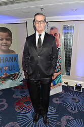 RUPERT EVERETT at the Chain of Hope Ball held in aid of the charity Chain of Hope, founded by Professor Sir Magdi Yacoub which organises volunteer teams worldwide to operate on children suffering from life-threatening heart diseases, held at the Grosvenor House Hotel, Park Lane, London on 20th November 2015.