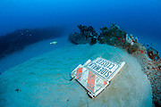 A road sign litters the ocean bottom offshore Singer Island, Florida, United States.