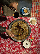 In Passu village, cooking diner of Maltashtze Giyaling (Hunza Pancakes) at the house of Bano and husband Inayat Faqir. Gojal Region.