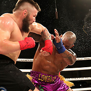 FORT LAUDERDALE, FL - FEBRUARY 15: Hector Lombard gets punched by David Mundell during the Bare Knuckle Fighting Championships at Greater Fort Lauderdale Convention Center on February 15, 2020 in Fort Lauderdale, Florida. (Photo by Alex Menendez/Getty Images) *** Local Caption *** Hector Lombard; David Mundell