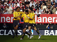 Photo: Olly Greenwood.<br />Charlton Athletic v Arsenal. The Barclays Premiership. 30/09/2006. Arsenal Robin Van Persie celebrates scoring with Gilberto and Cesc Fabregas
