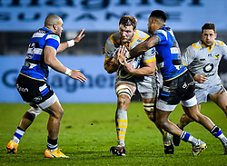 Anthony Watson of Bath Rugby attempts a tackle on Joe Launchbury of Wasps - Mandatory by-line: Andy Watts/JMP - 08/01/2021 - RUGBY - Recreation Ground - Bath, England - Bath Rugby v Wasps - Gallagher Premiership Rugby