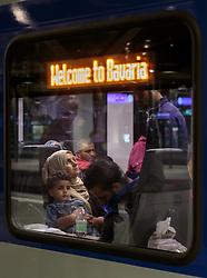 12.09.2015, Hauptbahnhof Salzburg, AUT, Fluechtlinge am Hauptbahnhof Salzburg auf ihrer Reise nach Deutschland, im Bild Flüchtlinge warten auf die Abfahrt des Zuges nach Muenchen. Der ÖBB Zugsverkehr nach Deutschland wurde eingestellt // Refugees wait for the departure of the train to Munich. According to reports Germany has stoped the Train Traffic from and into Austria, Main Train Station, Salzburg, Austria on 2015/09/12. EXPA Pictures © 2015, PhotoCredit: EXPA/ JFK