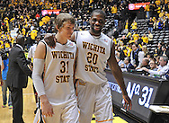 WICHITA, KS - JANUARY 18:  Players Ron Baker #31 and Kadeem Coleby #20 of the Wichita State Shockers walk off the court together after beating the Indiana State Sycamores on January 18, 2014 at Charles Koch Arena in Wichita, Kansas.  Wichita State defeated Indiana State 68-48. (Photo by Peter Aiken/Getty Images) *** Local Caption *** Ron Baker;Kadeem Coleby
