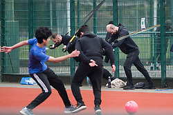 © Licensed to London News Pictures. 31/03/2020. London, UK. People exercise in close proximity and play football at Paddington Recreation Ground in London, during a lockdown to slow the spread of COVID-19. Members of the public have been told they can only leave their homes when absolutely essential, in an attempt to fight the spread of COVID-19, . Photo credit: Ben Cawthra/LNP
