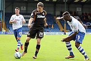 Newport County's  Conor Washington (c) stands up to Bury's Nathan Cameron. Skybet Football League two match, Bury v Newport county at Gigg Lane in Bury on Saturday 5th Oct 2013. pic by David Richards, Andrew Orchard sports photography,