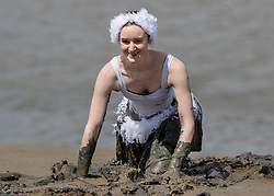 © Licensed to London News Pictures. 12/05/2019. Maldon, UK. A competitor dressed as a ballerina takes part in the Maldon Mud Race in Essex. The race originated in 1973 and involves competitors racing around a course on the mudbanks of the river Blackwater at low tide. Photo credit: Peter Macdiarmid/LNP