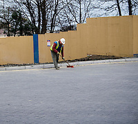 Construction worker sweeping at buildins site in Ireland