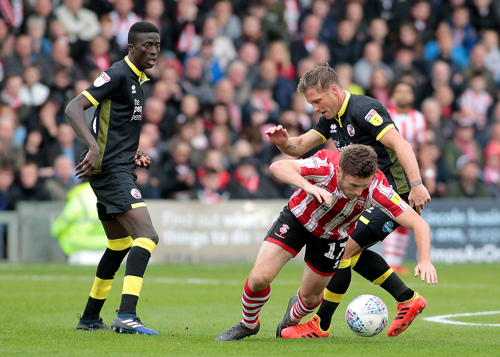 Lincoln City's Shay McCartan battles with Crawley Town's Dannie Bulman<br /> <br /> Photographer David Shipman/CameraSport<br /> <br /> The EFL Sky Bet League Two - Lincoln City v Crawley Town - Saturday September 8th 2018 - Sincil Bank - Lincoln<br /> <br /> World Copyright © 2018 CameraSport. All rights reserved. 43 Linden Ave. Countesthorpe. Leicester. England. LE8 5PG - Tel: +44 (0) 116 277 4147 - admin@camerasport.com - www.camerasport.com