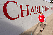 Senator Marlon Kimpson walks past the newly painted Charleston Strong wall mural during ceremonies October 21, 2015 in Charleston, South Carolina. The wall is to commemorate the mass shooting at the historic Mother Emanuel African Methodist Episcopal Church last June.