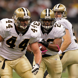 2009 October 04: New Orleans Saints running back Pierre Thomas (23) runs behind fullback Heath Evans (44) during the first half of a week four regular season game between the New Orleans Saints and the New York Jets at the Louisiana Superdome in New Orleans, Louisiana.