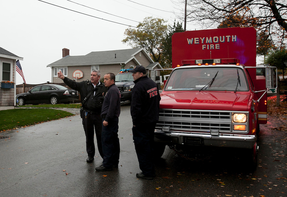 Weymouth, MA 10/29/2012<br /> Firefighters look at water flowing over the seawall on Wessaugusett Rd at Wittaumet Rd in Weymouth as Hurricane Sandy approaches New England on Monday.