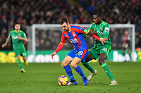 Football - 2018 / 2019 Premier League - Crystal Palace vs. Watford<br /> <br /> Crystal Palace's James McArthur holds off the challenge from Watford's Abdoulaye Doucoure, at Selhurst Park.<br /> <br /> COLORSPORT/ASHLEY WESTERN