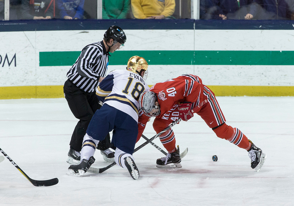 March 17, 2018:  Ohio State forward Ronnie Hein (40) and Notre Dame forward Jake Evans (18) battle in the face-off circle during NCAA Hockey game action between the Notre Dame Fighting Irish and the Ohio State Buckeyes at Compton Family Ice Arena in South Bend, Indiana.  Notre Dame defeated Ohio State 3-2 in overtime.  John Mersits/CSM