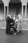 14/03/1964<br /> 03/14/1964<br /> 14 March 1964<br /> Ordination of Fr. Donal Sullivan at Holy Cross College (Clonliffe College), Clonliffe Road, Drumcondra, Dublin. Picture shows Fr. Donal Sullivan, C.M., Kenilworth, Ballinacurra, Co. Limerick, giving his blessing to his sister Mary. Also in image are his sister Winifred, and Mr and Mrs P. Sullivan.