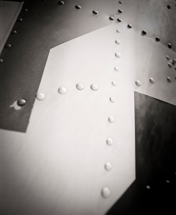 Abstraction of a painted numeral on a fully restored SBD-5 Dive Bomber.  Created with a plastic camera and black and white film.
