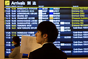 A Japanese man waits with a sign for an arriving passenger at Haneda International Airport, Tokyo, Japan. Friday February 1st 2019