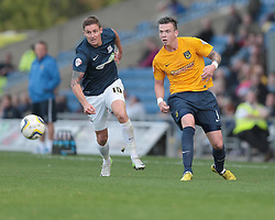 Oxford United's Michael Raynes passes back watched by Southend United's Barry Corr - Photo mandatory by-line: Nigel Pitts-Drake/JMP - Tel: Mobile: 07966 386802 05/10/2013 - SPORT - FOOTBALL - Kassam Stadium - Oxford - Oxford United v Southend United - Sky Bet League 2
