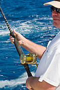 Angler holding light tackle outfit that is very low on line.