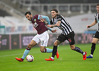 Football - 2021 / 2021 Premier League - Newcastle United vs Burnley - St Jame's Park<br /> <br /> Dwight McNeil of Burnley FC vies with Jeff Hendrick of Newcastle United<br /> <br /> <br /> COLORSPORT/BRUCE WHITE