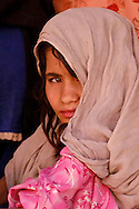 28 June 2004- Kabul, Afghanistan- A day in the life of Kabul, 7:45 AM, a young refuge girl from Pakistan waits in line for her polio vacination at the UN center for refuges returning home to Afghanistan..Photo Credit: Daniel Sullivan/SIpa Press