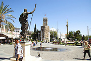 Turkey, Antalya, Statue of Attalos II The clock Tower in the background .
