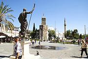 Turkey, Antalya, Statue of Attalos II The clock Tower in the background .