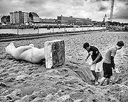 Ghent, Belgium, 13 aug 2011, Fresbee players are digging a hole to put a polar bear in it on Dok beach