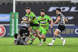 Northampton Saints' Teimana Harrison is tackled by Ospreys' Tom Habberfield<br /> <br /> Photographer Craig Thomas/Replay Images<br /> <br /> EPCR Champions Cup Round 4 - Ospreys v Northampton Saints - Sunday 17th December 2017 - Parc y Scarlets - Llanelli<br /> <br /> World Copyright © 2017 Replay Images. All rights reserved. info@replayimages.co.uk - www.replayimages.co.uk