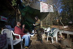 © Licensed to London News Pictures. 02/03/2017. Coldharbour, UK. Protestors talk at the 'Protection Camp' on Leith Hill. Activists have constructed and occupied a fort and some trees on the site of a proposed oil well. Planning permission for 18 weeks of exploratory drilling was granted to Europa Oil and Gas in August 2015 after a four-year planning battle. The camp was set up by protestors in October 2016 in order to draw  attention to plans to drill in this Area of Outstanding Natural Beauty (AONB) in the Surrey Hills. The camp has received support from the local community.  Photo credit: Peter Macdiarmid/LNP