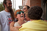 31 JULY 2010 - PHOENIX, AZ: Freed protesters congratulate each other upon their release from the 4th Ave Jail in Phoenix Saturday. The last of the people arrested in Phoenix for protesting against Arizona's tough anti-illegal immigration law, SB 1070, were released from the 4th Ave Jail in Phoenix, AZ, Saturday morning. More than 60 people have been arrested for various charges related to peaceful protests that have been held across the city during marches and demonstrations against SB 1070 and Maricopa Sheriff Joe Arpaio's controversial crime sweeps which take place in heavily Hispanic neighborhoods.   Photo by Jack Kurtz
