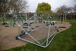 © Licensed to London News Pictures. 28/03/2021. London, UK. The fence blocking the outdoor gym in Chestnuts Park in north London is vandalised. The next phase of easing of lockdown restrictions on Monday 29 March, will see outdoor exercise being allowed. Photo credit: Dinendra Haria/LNP