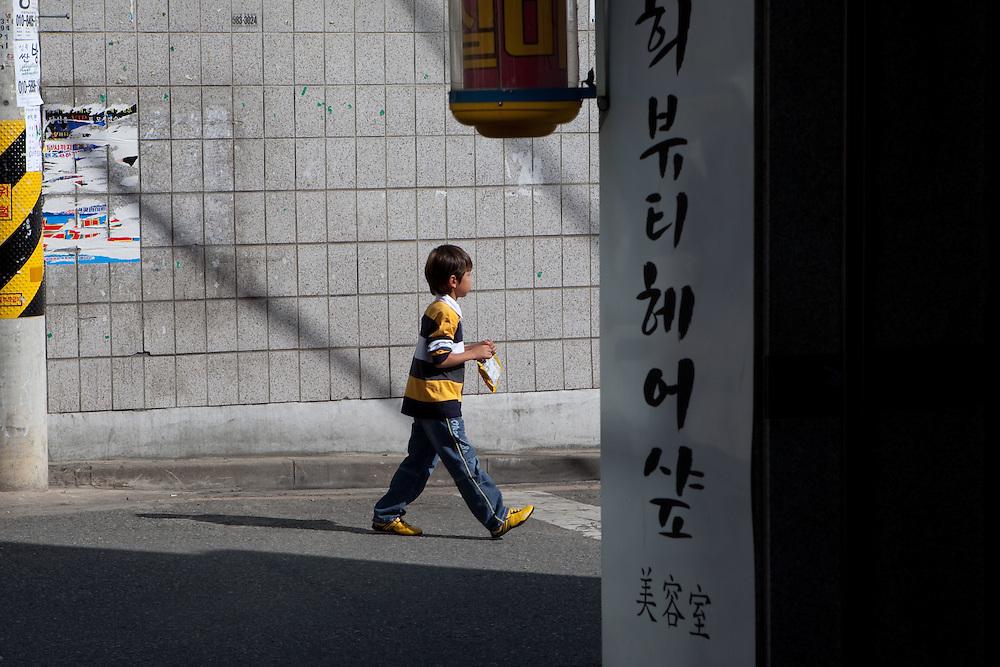 Daegu/South Korea, Republic Korea, KOR, 03.10.2009: Boy on the street of the South Korean city Daegu.