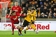 Manchester United Midfielder Jesse Lingard battles with Wolverhampton Wanderers midfielder Joao Moutinho (28) during the The FA Cup match between Wolverhampton Wanderers and Manchester United at Molineux, Wolverhampton, England on 16 March 2019.