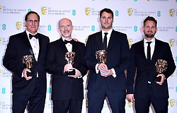 Geoffrey Baumann, Jesse James Chisholm, Craig Hammack and Dan Sudick with their Best Special Visual Effects Bafta for Black Panther in the press room at the 72nd British Academy Film Awards held at the Royal Albert Hall, Kensington Gore, Kensington, London.