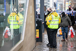 © Licensed to London News Pictures. 02/12/2020. Manchester, UK. Covid Marshals patrol Market Street, Manchester as the city enters Tier 3 restrictions.  Photo credit: Kerry Elsworth/LNP