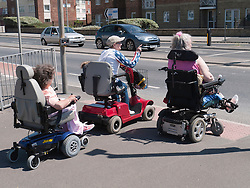 Wheelchair users crossing the road..(Not cleared for newspaper and television use)
