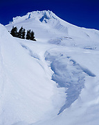 Snow-covered and glacier-clad volcanic summit of 11,240-foot Mount Hood, Cascade Range, Mount Hood National Forest, Oregon.